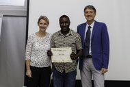 James Kisekka (C) received award from Titia Wouters (L) & Dick Bouman (R)