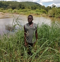 Farmer at the point where river Muenedzi joins river Revue, Mozambique.