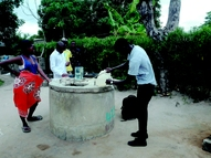 Sample and data collection from a well in Manjacaze, Mozambique.