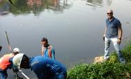 Installing measurement equipment in Angke River