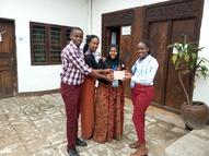 WWX-Yepper from Zambia receiving YEP Tile from Tanzanian Yeppers