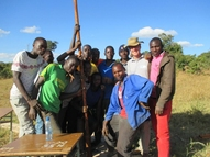 Teaching students how to remove and install a hand pump
