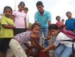 Manually drilled trial well draws skills and water